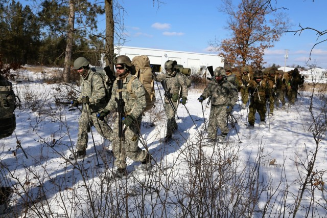 Students in the Cold-Weather Operations Course Class 18-04 participate in snowshoe training Feb. 7, 2018, at a training space on the cantonment area at Fort McCoy, Wis. The students were Marines with units with the 2nd Marine Aircraft Wing of Marine Corps Air Station Cherry Point, N.C., and Soldiers from various other units. In addition to snowshoeing, students are trained on a variety of cold-weather subjects, including skiing as well as how to use ahkio sleds and other gear. Training also focuses on terrain and weather analysis, risk management, cold-weather clothing, developing winter fighting positions in the field, camouflage and concealment, and numerous other areas that are important to know in order to survive and operate in a cold-weather environment. The training is coordinated through the Directorate of Plans, Training, Mobilization and Security at Fort McCoy. (U.S. Army Photo by Scott T. Sturkol, Public Affairs Office, Fort McCoy, Wis.)