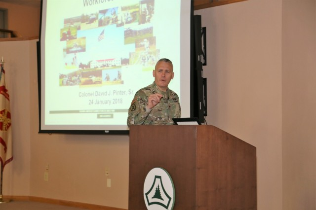 Garrison Commander Col. David J. Pinter Sr. provides his annual briefing to the Fort McCoy workforce Jan. 24, 2018, in building 905 at Fort McCoy, Wis. Pinter held two workforce briefings to hundreds of Fort McCoy employees where he discussed many plans, programs, and future efforts at the installation. (U.S. Army Photo by Scott T. Sturkol, Public Affairs Office, Fort McCoy, Wis.)