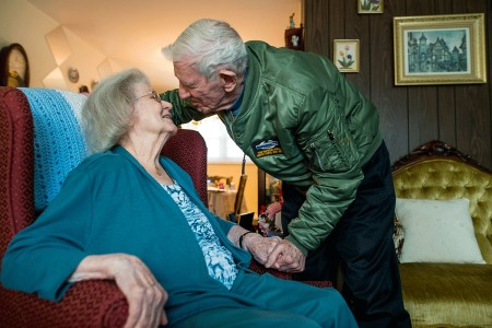 """Retired Sgt. Maj. Raymond Moran, affectionately known as the """"Old Soldier,"""" leans in to kiss his wife of 65 years marriage at their home in Odenton, Md., Feb. 11, 2018. The Morans officially celebrate their wedding anniversary on Valentine's Day. They were married Feb. 14, 1953. With this milestone, their years of marriage match the same number of years Moran committed to service in the Army and Army Reserve. Raymond enlisted in 1948, and served in Korea, Vietnam, Japan, Cambodia and during Desert Storm. He spent 30 years on active duty and 35 years as a civilian recruiter in the U.S. Army Reserve. He was instrumental in standing up the 220th Military Police Brigade, which has since become the 200th MP Command and is the largest military police organization in the DOD."""