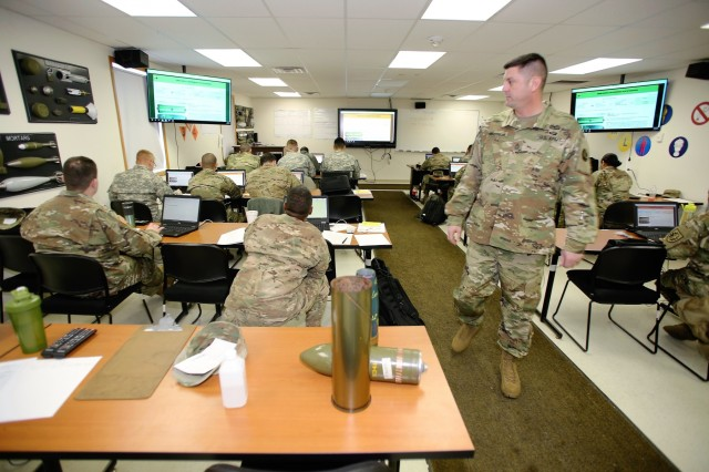 Instructor Sgt. 1st Class Jeremy VanStreain with the 13th Battalion, 100th Regiment teaches students in the 89B Ammunition Supply Course Jan. 16, 2018, at Fort McCoy, Wis. The 13th, 100th is an ordnance battalion that provides training and training support to Soldiers in the ordnance maintenance military occupational specialty (MOS) series. The unit, aligned under the 3rd Brigade, 94th Division of the 80th Training Command, has been at Fort McCoy since about 1995. (U.S. Army Photo by Scott T. Sturkol, Public Affairs Office, Fort McCoy, Wis.)