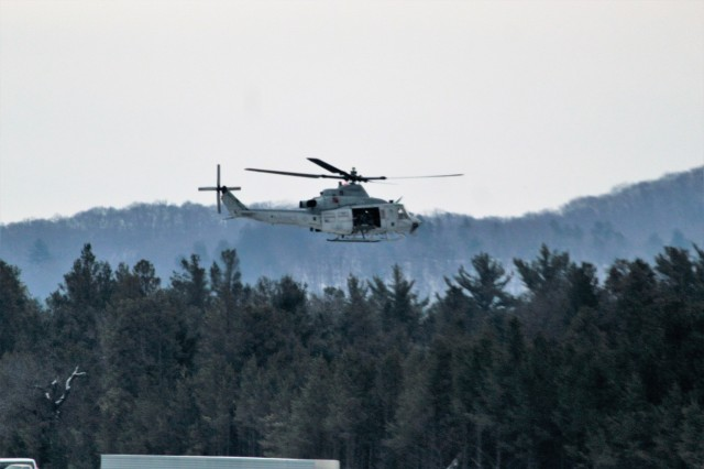 A Marine Corps UH-1Y Venom helicopter at the installation for the 2nd Marine Aircraft Wing's Ullr Shield exercise takes off from Young Air Assault Strip on South Post on Jan. 24, 2018, at Fort McCoy, Wis. Ullr Shield is a training exercise designed to improve 2nd Marine Aircraft Wing's capabilities in extreme cold-weather environments from early January to early February 2018. The 2nd Marine Aircraft Wing is headquartered at Marine Corps Air Station Cherry Point, N.C. Hundreds of Marines participated in the exercise at Fort McCoy. (U.S. Army Photo by Scott T. Sturkol, Public Affairs Office, Fort McCoy, Wis.)