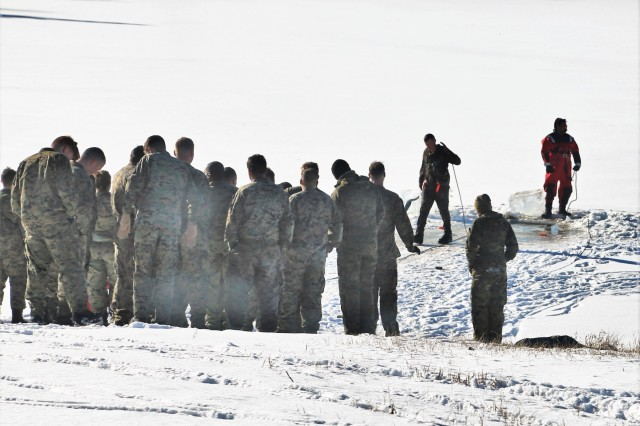 Marines at Fort McCoy for the 2nd Marine Air Wing's Ullr Shield exercise participate in cold-water immersion training at Big Sandy Lake on South Post on Jan. 17, 2018, at Fort McCoy, Wis. Ullr Shield is a training exercise designed to improve 2nd Marine Aircraft Wing's capabilities in extreme cold-weather environments. The 2nd Marine Aircraft Wing is headquartered at Marine Corps Air Station Cherry Point, N.C. Hundreds of Marines participated in the exercise at Fort McCoy. (U.S. Army Photo by Scott T. Sturkol, Public Affairs Office, Fort McCoy, Wis.)