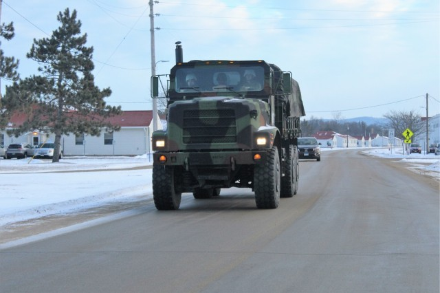 Marines at Fort McCoy for the 2nd Marine Air Wing's Ullr Shield exercise operate military tactical vehicles on the cantonment area on Jan. 18, 2018, at Fort McCoy, Wis. Ullr Shield is a training exercise designed to improve 2nd Marine Aircraft Wing's capabilities in extreme cold-weather environments. The 2nd Marine Aircraft Wing is headquartered at Marine Corps Air Station Cherry Point, N.C. Hundreds of Marines participated in the exercise at Fort McCoy. (U.S. Army Photo by Scott T. Sturkol, Public Affairs Office, Fort McCoy, Wis.)