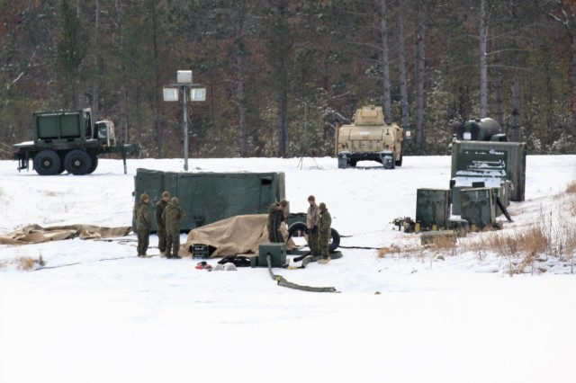 Marines at Fort McCoy for the 2nd Marine Air Wing's Ullr Shield exercise manage water filtration operations at Big Sandy Lake on South Post on Jan. 17, 2018, at Fort McCoy, Wis. Ullr Shield is a training exercise designed to improve 2nd Marine Aircraft Wing's capabilities in extreme cold-weather environments. The 2nd Marine Aircraft Wing is headquartered at Marine Corps Air Station Cherry Point, N.C. Hundreds of Marines participated in the exercise at Fort McCoy. (U.S. Army Photo by Scott T. Sturkol, Public Affairs Office, Fort McCoy, Wis.)