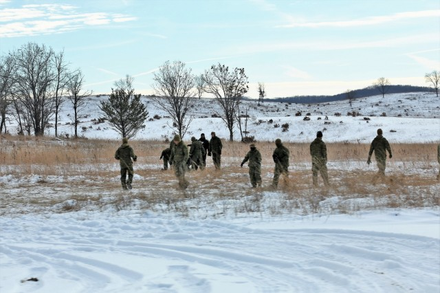 Marines at Fort McCoy for the 2nd Marine Air Wing's Ullr Shield exercise operate in an area near Badger Drop Zone on South Post on Jan. 17, 2018, at Fort McCoy, Wis. Ullr Shield is a training exercise designed to improve 2nd Marine Aircraft Wing's capabilities in extreme cold-weather environments. The 2nd Marine Aircraft Wing is headquartered at Marine Corps Air Station Cherry Point, N.C. Hundreds of Marines participated in the exercise at Fort McCoy. (U.S. Army Photo by Scott T. Sturkol, Public Affairs Office, Fort McCoy, Wis.)