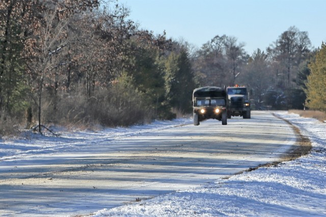 Marines at Fort McCoy for the 2nd Marine Air Wing's Ullr Shield exercise operate military tactical vehicles on South Post on Jan. 17, 2018, at Fort McCoy, Wis. Ullr Shield is a training exercise designed to improve 2nd Marine Aircraft Wing's capabilities in extreme cold-weather environments. The 2nd Marine Aircraft Wing is headquartered at Marine Corps Air Station Cherry Point, N.C. Hundreds of Marines participated in the exercise at Fort McCoy. (U.S. Army Photo by Scott T. Sturkol, Public Affairs Office, Fort McCoy, Wis.)