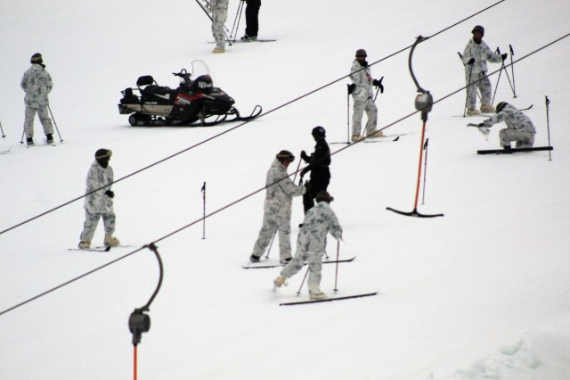 Students in the Fort McCoy Cold-Weather Operations Course Class 18-03 learn to ski and about skiing techniques Jan. 25, 2018, at Whitetail Ridge Ski Area at Fort McCoy, Wis. The students included Marines with the 2nd Marine Aircraft Wing of Marine Corps Air Station Cherry Point, N.C., and Soldiers with the 181st Multi-Functional Training Brigade at Fort McCoy. In addition to skiing, students are trained on a variety of cold-weather subjects, including snowshoe training as well as how to use ahkio sleds and other gear. Training also focuses on terrain and weather analysis, risk management, cold-weather clothing, developing winter fighting positions in the field, camouflage and concealment, and numerous other areas that are important to know in order to survive and operate in a cold-weather environment. The training is coordinated through the Directorate of Plans, Training, Mobilization and Security at Fort McCoy. (U.S. Army Photo by Scott T. Sturkol, Public Affairs Office, Fort McCoy, Wis.)