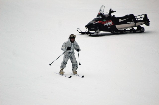 A student in the Fort McCoy Cold-Weather Operations Course Class 18-03 learns to ski and about skiing techniques Jan. 25, 2018, at Whitetail Ridge Ski Area at Fort McCoy, Wis. Course students included Marines with the 2nd Marine Aircraft Wing of Marine Corps Air Station Cherry Point, N.C., and Soldiers with the 181st Multi-Functional Training Brigade at Fort McCoy. In addition to skiing, students are trained on a variety of cold-weather subjects, including snowshoe training as well as how to use ahkio sleds and other gear. Training also focuses on terrain and weather analysis, risk management, cold-weather clothing, developing winter fighting positions in the field, camouflage and concealment, and numerous other areas that are important to know in order to survive and operate in a cold-weather environment. The training is coordinated through the Directorate of Plans, Training, Mobilization and Security at Fort McCoy. (U.S. Army Photo by Scott T. Sturkol, Public Affairs Office, Fort McCoy, Wis.)