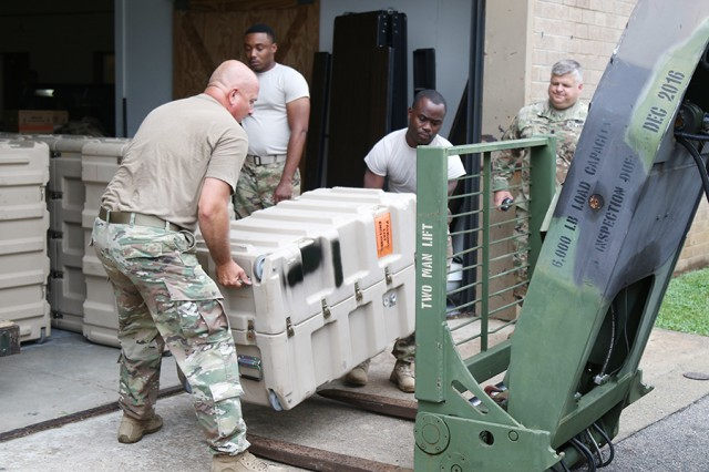 Soldiers from the 135th Expeditionary Sustainment Command prepare for a deployment by packing weapons and equipment on June 21, 2017, in Birmingham, Ala.