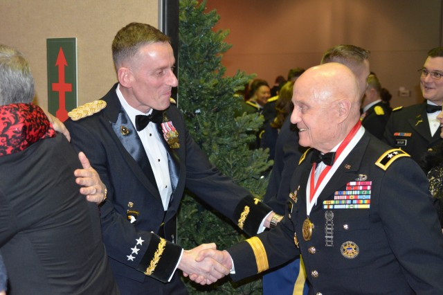 Lt. Gen. Gary J. Volesky, commanding general of America's First Corps and Joint Base Lewis McChord, greets Maj. Gen. (Ret.) Thomas F. Cole during the receiving line of the corps's centennial ball at the Murano Hotel, February 10, 2018. Gen. Cole's 36-year military career includes combat in the Korean and Vietnam wars along with tours in Japan, Germany, and high command in the United States. He retired as the Deputy Commander of the Sixth United States Army.