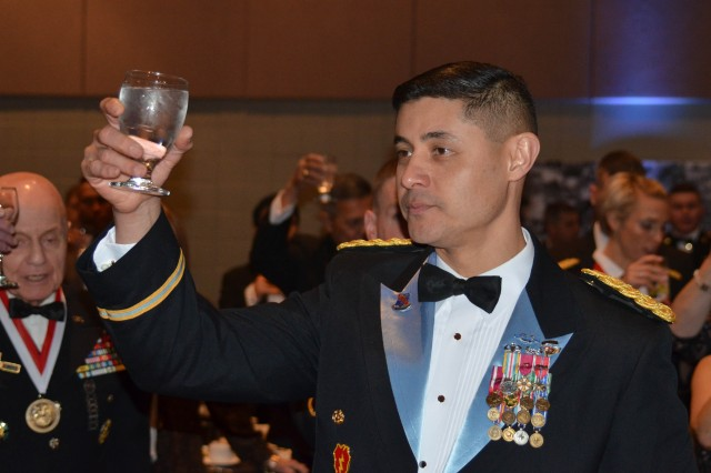 Col. Mario Diaz, I Corps chief of staff, raises a charged glass in toast as part of the opening ceremonies of the I Corps centennial ball at the Murano Hotel, February 10, 2018. Various toasts are offered during the formal night of events in honor of the nation, its leaders and its Soldiers, past and present.