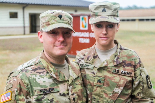 From left, Mississippi Army National Guard Spc. Christopher C. Fields, a cavalry scout assigned to Troop B, 1st Battalion, 98th Cavalry Regiment, 155th Armored Brigade Combat Team, and Mississippi Army National Guard Sgt. Chasidy Fields, a human resource specialist assigned to Headquarters Company, 155th Armored Brigade Combat Team pose for a photo at Camp Shelby Joint Force Training Center, Miss., Feb. 14, 2018. The Fields are just one of several married military couples preparing for an upcoming deployment to the Middle East in support of Operation Spartan Shield.
