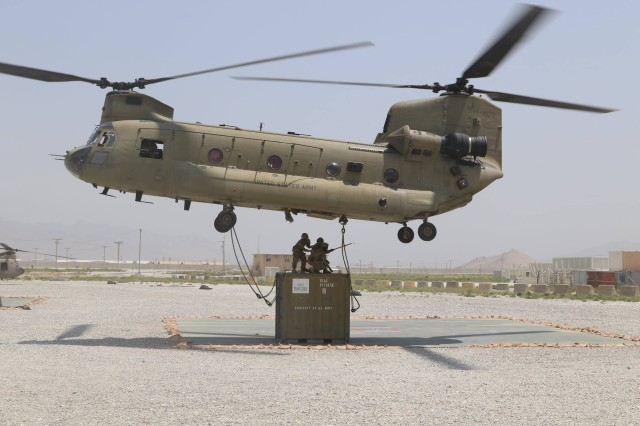 A CH-47 Chinook picks up cargo from Bagram Airfield, Afghanistan, May 22, 2017. Soldiers assigned to the 1st Armored Division Sustainment Brigade managed the flights, personnel and cargo for Chinook transports during their deployment to Afghanistan last year.