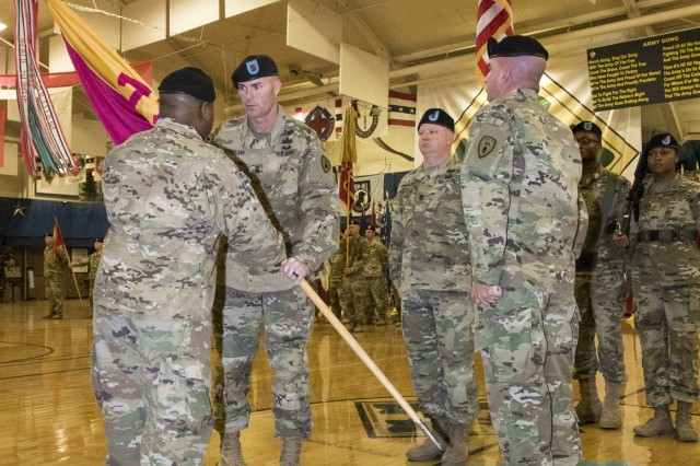 Col. Frank Davis II, commander of 71st Ordnance Group (Explosive Ordnance Disposal), hands Command Sgt. Maj. Johnny Strickland, incoming command sergeant major of 71st EOD, the unit's colors during a change of responsibility ceremony, Feb. 9, 2018, at the William Reed Special Events Center, Fort Carson, Colo. (U.S. Army photo by Staff Sgt. Lance Pounds, 71st Ordnance Group (EOD), Public Affairs)