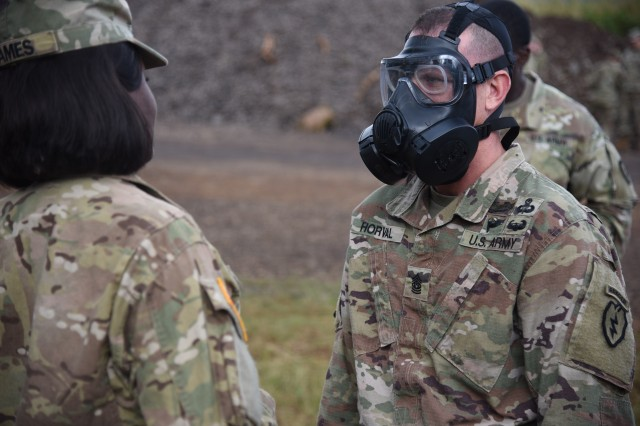 Command Sgt. Maj. Sean Horval, senior enlisted advisor for 2nd Infantry Brigade Combat Team, 25th Infantry Division has his mask inspected to tests the seal of his mask before entering a gas chamber here on Schofield Barracks, Hawaii on Feb. 5, 2018. The purpose of Chemical, Biological, Radiological and Nuclear (CBRN) training is to teach Soldiers the importance of properly applying a gas mask and other protective gear in order to potentially save lives in dangerous situations.