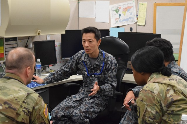 Japan Self-Defense Forces Lt. Col. Takeshi Murakami a Joint Theater Air Missile Defense coordinator talks in a conference call with members of the 94th Army Air & Missile Defense Command and liaison officers in Yokota Air Force base during the annual command post exercise Keen Edge 18, held 26 Jan. to 3 Feb. at Joint Base Pearl Harbor Hickam.The exercise allowed service members to hone and refine the steps they would take in the event of a crisis or contingency while executing integrated air and missile defense operations supporting the Pacific theater operation plans along with U.S. allies.