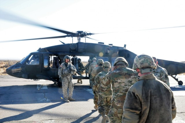 Two UH-60 Black Hawks from A Company, 2nd Battalion, 501st Aviation Regiment, flew Soldiers from the 79th Infantry Brigade Combat Team over Camp McGregor, New Mexico, on Feb. 9 as part of training for a stabilization and security mission in Kosovo.