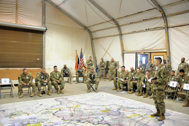 Capt. Greg Schulman, the 79th Infantry Brigade Combat Team medical officer, briefs the command during a Combined-arms Rehearsal Feb. 12 at Camp McGregor, New Mexico.