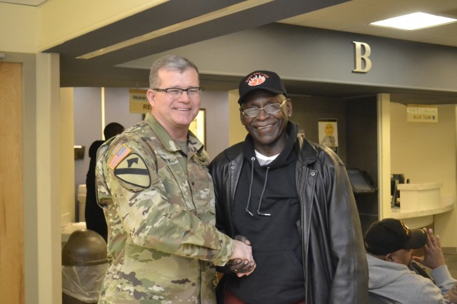 Army Brig. Gen. Mark Simerly, DLA Troop Support commander, shakes hands with a patient at the Corporal Michael J. Crescenz Veterans Affairs Medical Center Feb. 12, 2018 in Philadelphia. Volunteers from DLA Troop Support visited medical center in support of National Salute to Veteran Patients Week.