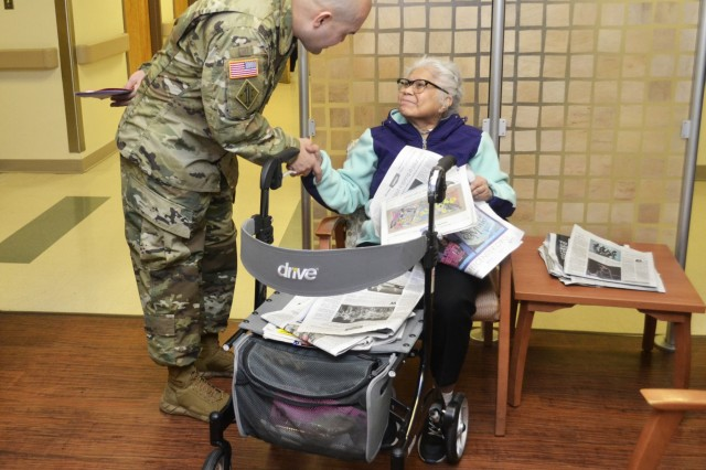 Army Master Sgt. Jose Moraga introduces himself to a patient waiting for care at the Corporal Michael J. Crescenz Veterans Affairs Medical Center, Feb. 12, 2018 in Philadelphia. Volunteers from DLA Troop Support visited the medical center in support of National Salute to Veteran Patients Week.