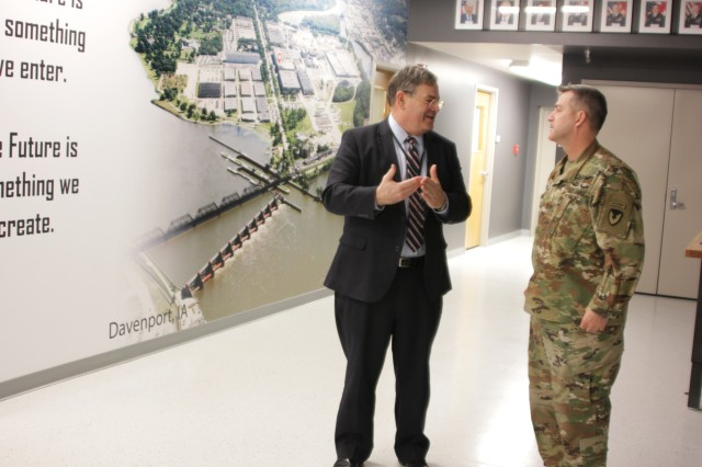 Jeffrey White, the principal deputy assistant secretary of the Army Acquisition, Logistics and Technology, discusses advanced manufacturing with Col. Ken Letcher, Rock Island Arsenal Joint Manufacturing and Technology Center commander, during a visit to RIA-JMTC Feb. 7.