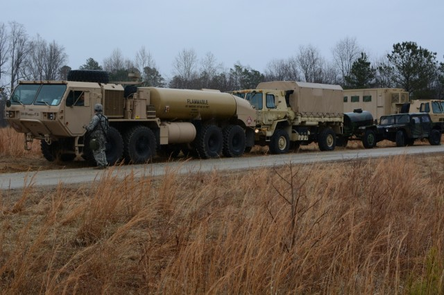 Soldiers of the 55th Sustainment Brigade, stage vehicles in preparation for movement from their area of operation at Fort A.P. Hill, Va., to Fort Belvoir, Va. toward the end brigade's field training exercise, Operation Heinz, Feb. 1 2018 (U.S. Army Photo by Staff Sgt. Luis Delgadillo).