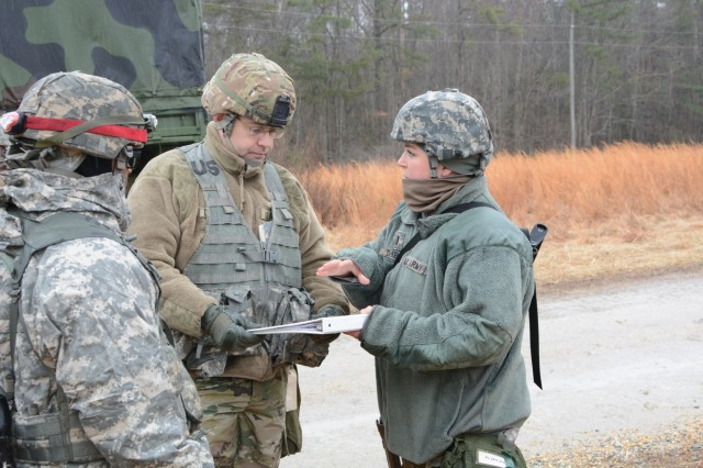 First Lt. Raquel McKenna (right), executive officer for Headquarters and Headquarters Company, of the 55th Special Troops Battalion, 55th Sustainment Brigade, briefs Col. Troy A. D'Agostino, commander of the 55th Sus. Bde., about the movement returning the brigade back to Fort Belvoir, Va. during Operation Heinz, Feb. 1 2018 (U.S. Army Photo by Staff Sgt. Luis Delgadillo).