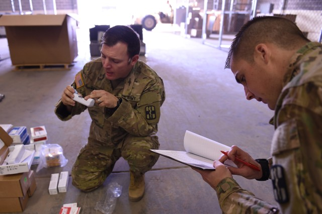Soldiers from the 745th Forward Surgical Team, a detachment of the 31st Combat Support Hospital, conduct a joint inventory as they receive medical equipment and supplies in support of their conversion into a Forward Resuscitation and Surgical Team at Fort Bliss, Texas, Feb. 6.