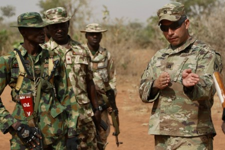 A Soldier with Security Assistance and Training Management Organization, describes a file movement to a Nigerian Army Soldier during the seven-week infantry training course at Jaji, Nigeria, facilitated by U.S. Army Africa.