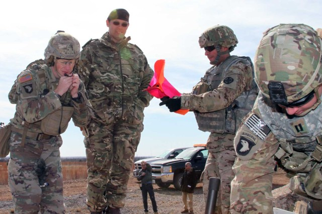 British Army Reserve Lt. Col. Nick Sargent (wearing) beret) talks with Fort Sill Soldiers as they wrap up their Joint Fires Observers recertification Jan. 30, 2018, at Falcon Range. Sargent, an exchange officer at the Army Targeting Center, earlier recertified as a Joint Terminal Attack Controller instructor/evaluator.