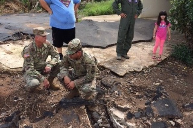"A military assessment team discusses hurricane damage with a 5-year-old girl at her home in Puerto Rico. When asked what message she would like for them to convey to the leaders for Joint Task Force Puerto Rico, she answered with, ""Fix the hole!"""