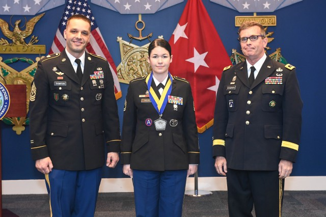 Sgt. 1st Class Aimee Fields, center, poses for a photo with Sgt. Maj. Mark Thompson, senior Army career counselor, left, and Lt. Gen. Thomas Seamands, the Army's G-1, during an award ceremony for the Secretary of the Army Career Counselor of the Year in the Pentagon in Arlington, Va., Feb. 7, 2018. Fields was selected as the active component winner in this year's competition.