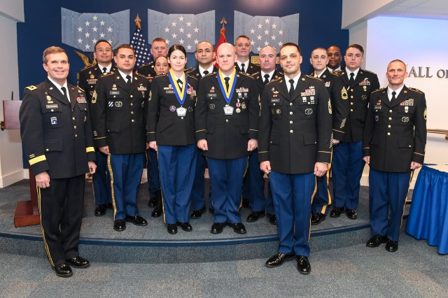 Sgts. 1st Class Aimee Fields and Joseph Compton, center, are awarded a newly-minted medal that honors the late Sgt. Maj. Jerome L. Pionk, a former senior Army career counselor, during the Secretary of the Army Career Counselor of the Year ceremony in the Pentagon in Arlington, Va., Feb. 7, 2018.