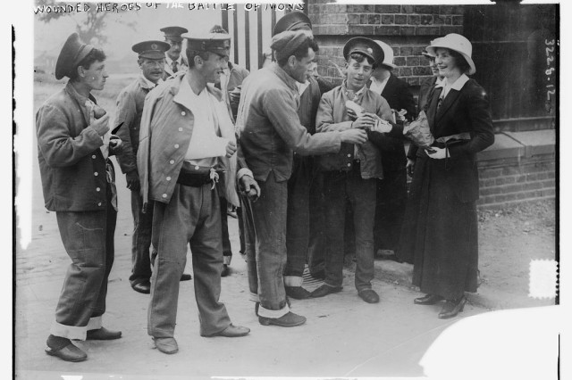 In an undated photo, a woman talks to Soldiers who were wounded in the Battle of Mons which took place on Aug. 23, 1914 in Belgium during World War I.