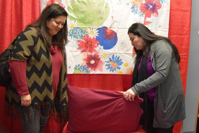 Bonnie Jones and Rosie Hillburn, Family Readiness Support assistants, look for signs of drug and alcohol use in a mock teenager's bedroom during the Hidden iN Plain Sight training at Kaiserslautern High School, Feb. 13.