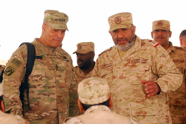 U.S. Army Lt. Gen. Michael X. Garrett, commanding general of Army Central (left), and Maj. Gen. Khaled Saleh Al-Sabah, Kuwait Army land forces commander, meet with soldiers assigned to the Kuwait Army during Army Day at Camp Buehring Feb. 9, 2018. Army Day was the opening event for U.S. Central Command's Component Commanders Conference that allowed U.S. Army Central to showcase the Army's capabilities at the theater level.