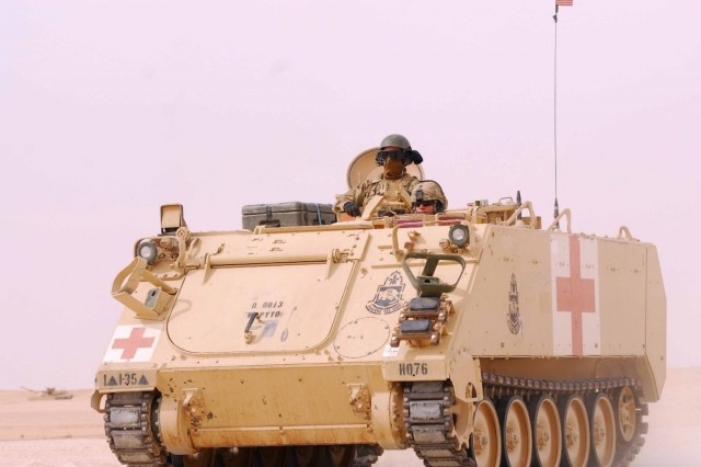 U.S. Army Soldiers assigned to the 1st Battalion, 35th Armored Regiment race down range in an M2 Bradley tank to simulate rescuing a wounded soldier during Army Day at Camp Buehring Feb 9, 2018. Army Day was the opening event for U.S. Central Command's Component Commanders Conference that allowed U.S. Army Central to showcase the Army's capabilities at the theater level.