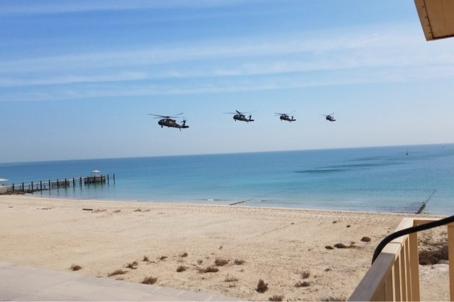 A formation of UH-60 Black Hawks assigned to the 1st Battalion, 244th Aviation Regiment (Assault), 2nd Brigade Combat Team, 1st Armored Division, approaches a beach to pick up distinguished visitors during Army Day at Kuwait Naval Base Feb. 9, 2018. Army Day was the opening event for U.S. Central Command's Component Commanders Conference that allowed U.S. Army Central to showcase the Army's capabilities at the theater level.