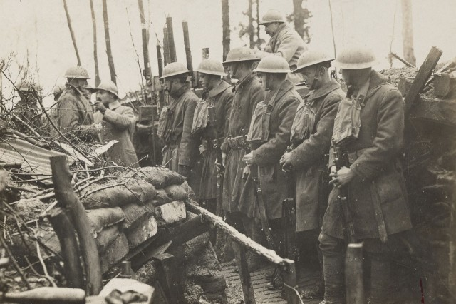 "A French instructor introduces National Guard Soldiers of the 42nd ""Rainbow"" Division to life in the trenches during World War I. French instructors taught American Soldiers the basics of trench warfare as the Americans prepared to enter combat in the winter of 1918."