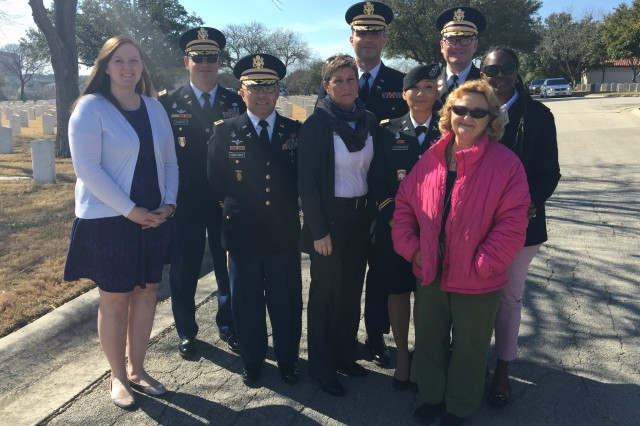 Members of the U.S. Army Medical Department's Professional Education and Training Department pose for a photo at the Fort Sam Houston Cemetery in January 2018. The group attended a funeral for a former co-worker after Cheryl Broussard, center, ensured the veteran was buried with honors.