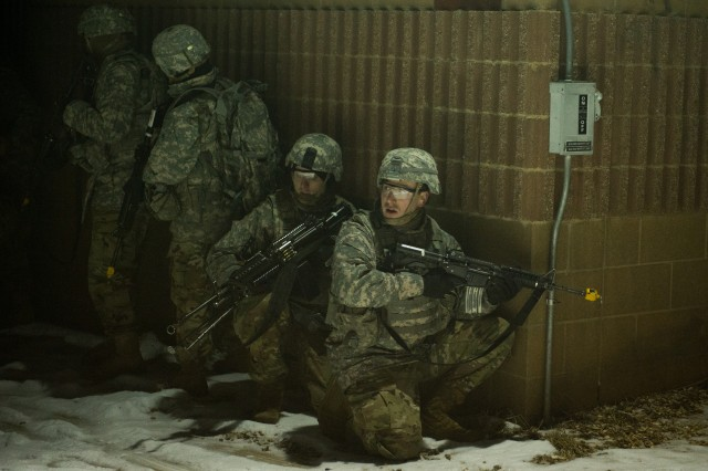 Engineering officers prepare to clear a building during a field training exercise Jan. 19, 2018, on Fort Leonard Wood, Missouri. Engineering officers, or 12As, are responsible for providing a wide range of engineering support to the Army. To qualify as a 12A, each officer must complete the 20-week Engineer Basic Officer Leaders Couse at Fort Leonard Wood.