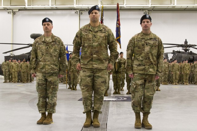 Col. Clair A. Gill, commander of the 10th Combat Aviation Brigade, stands in formation alongside Lt. Col. Adam Hodges (left), outgoing commander of 1-10 Attack Reconnaissance Battalion, and Lt. Col. James Scullion (right), the battalion's incoming commander, on February 8 at Fort Drum, New York. Scullion comes to the battalion from a position at the Pentagon as the executive officer for the Army's Inspector General.  (U.S. Army photo by Spc. Thomas Scaggs) 170208-A-TZ475-101