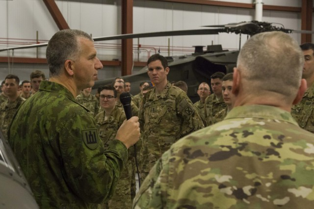 Lithuanian Col. Alvydas Šiuparis, Defense Attaché at the Lithuanian Embassy, addresses a formation of Soldiers from 3-10 General Support Aviation Battalion on February 11 at Fort Drum, New York. Soldiers were being presented the Lithuanian Armed Forces Medal for Mutual Support in order to recognize the Soldiers for their hard work during a recent rotation to Europe in support of Atlantic Resolve. (U.S. Army photo by Spc. Thomas Scaggs) 170209-A-TZ475-013