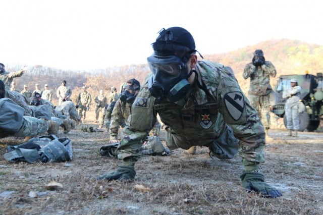 A soldier assigned to 3rd Battalion, 16th Field Artillery Regiment, conducts pushup drills during chemical, biological, radiological and nuclear training at Camp Casey, South Korea, Nov. 9, 2017. The Department of Defense is re-examining policies to make sure that as many Soldiers as possible maintain deployable status.