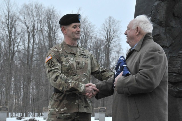 Hal Greer, Fort Drum's FMWR director, was honored among family, friends and colleagues Feb. 15 at Memorial Park when Maj. Gen. Walter E. Piatt, 10th Mountain Division (LI) and Fort Drum commander, presented him with the American flag that had just been lowered at division headquarters. Greer is set to retire Feb. 28 after 53 years of federal service, 19 of which he served at Fort Drum.