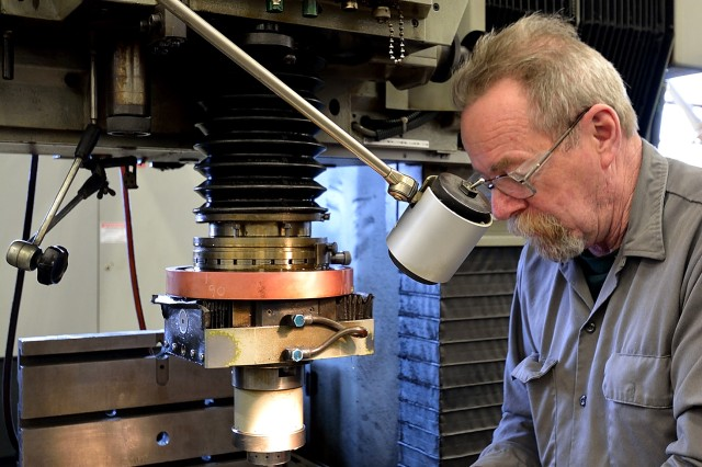 Watervliet Arsenal Toolmaker Lester Douglas is machining a firing block assembly this month for another order to support the Paladin howitzer system.  The new $13.5 million order awarded this month by the U.S. Army will require the Arsenal to machine similar parts but at tighter tolerances and a harder materiel.