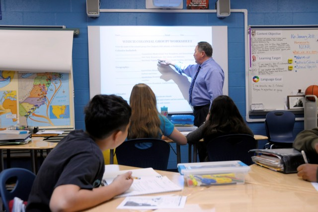 Since 2013, now-retired Chief Warrant Officer 5 Carlton Jenkins has been serving as a sixth-grade social studies instructor, teaching American history at Lake Ridge Middle School in Woodbridge, Virginia.