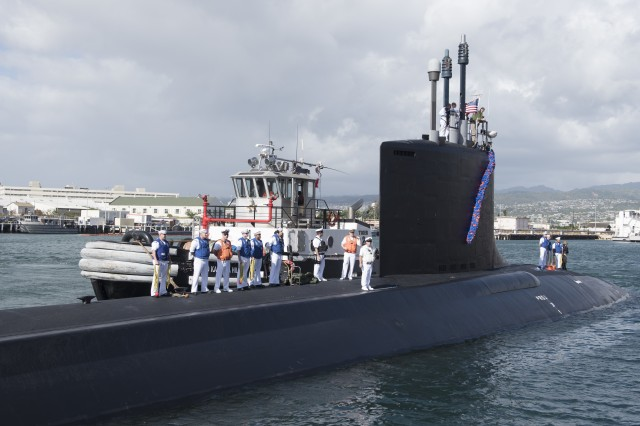 A Virginia-class attack submarine USS Illinois (SSN 786) arrives at Joint Base Pearl Harbor-Hickam, after completing a change of homeport from Groton, Connecticut, Nov. 22. USS Illinois is the 13th Virginia-class nuclear submarine and the 5th Virginia-class submarine homeported in Pearl Harbor.