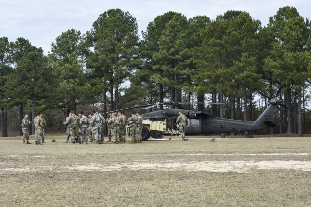 Soldiers with the South Carolina Army National Guard attend the Pathfinder course held at McCrady Training Center, Eastover, South Carolina, Feb. 14, 2018. The Pathfinder course is a two week class where Soldiers are tested in three different phases to include sling loading, helicopter landing zones (HLZ) and drop zones.