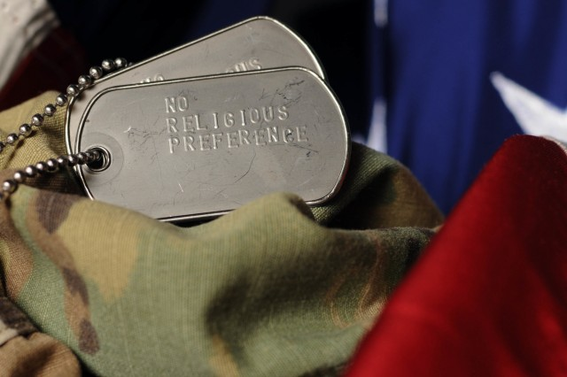 "A set of dog tags embossed with the phrase ""No Religious Preference"" represents the 49.5% of Massachusetts Army National Guardsmen who do not declare any particular faith or religion on their official record.  Despite the growing number of non religious personnel, military chaplains still play an essential role in maintaining the morale and welfare of the organization."